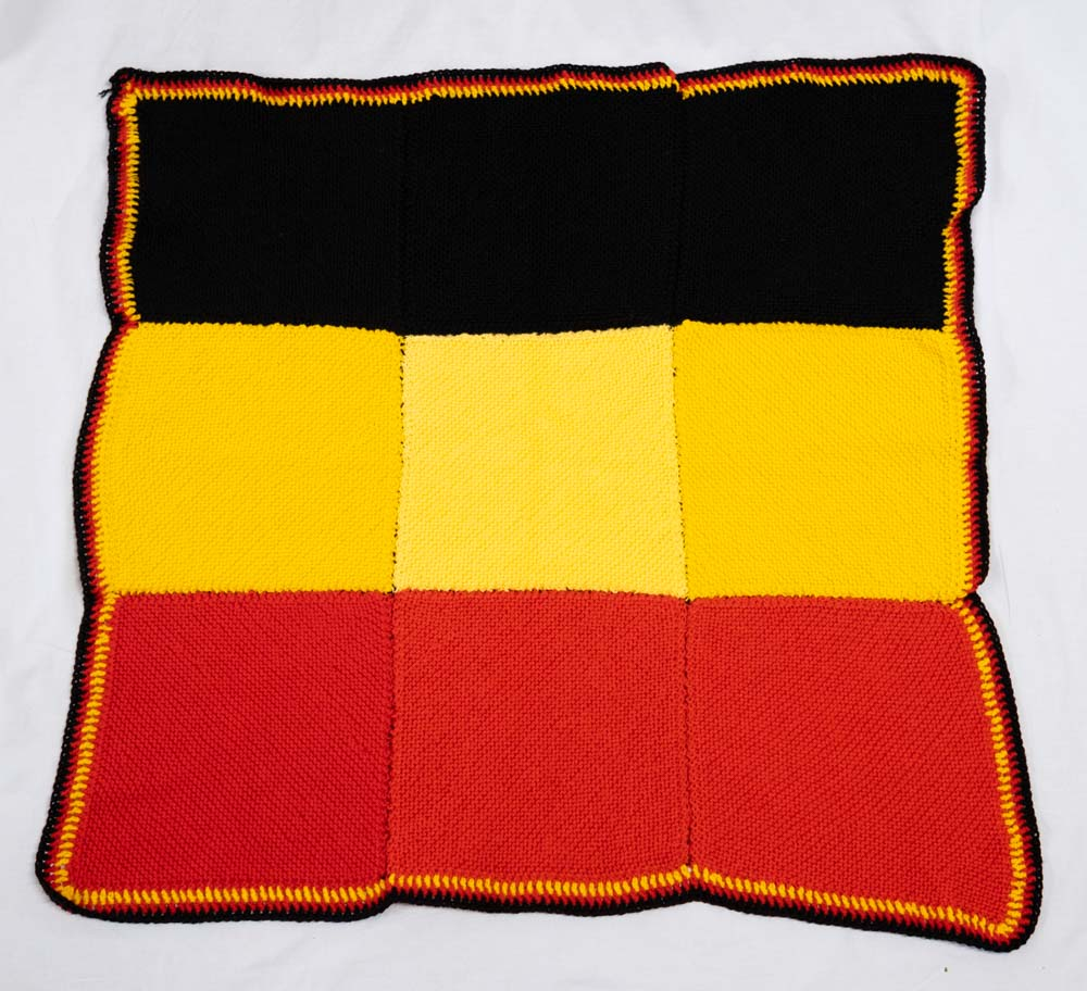 betty smith_gerringong rac_knitted knee rug in aboriginal colours